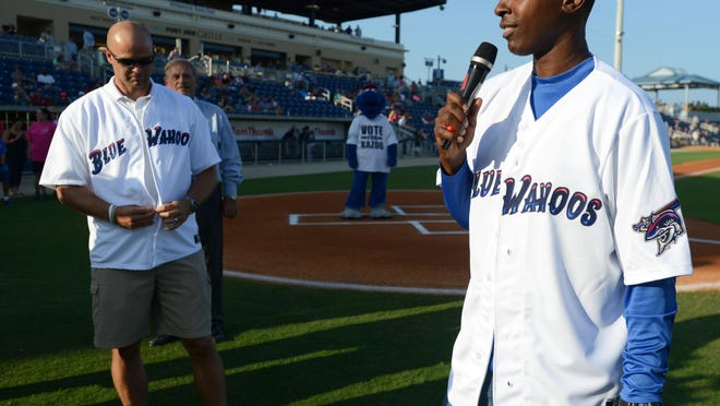 Charlie Ward, shown speaking with fellow Heisman Trophy winner Danny Wuerffel last year when the two were honored by the Pensacola Blue Wahoos, will host a football  father-son and mentor clinic on Saturday at the stadium.