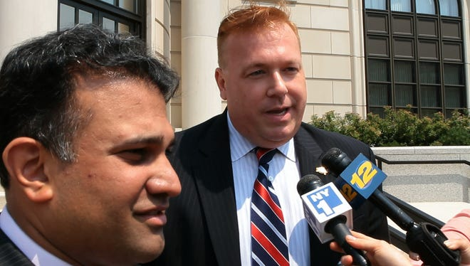 Former New York City Councilman Daniel Halloran talks with reporters as he leaves the Federal Courthouse in White Plains July 19, 2013.  ( Matthew Brown / The Journal News )