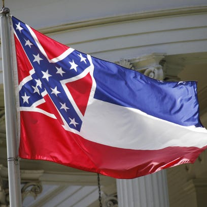 The state flag of Mississippi is unfurled against the