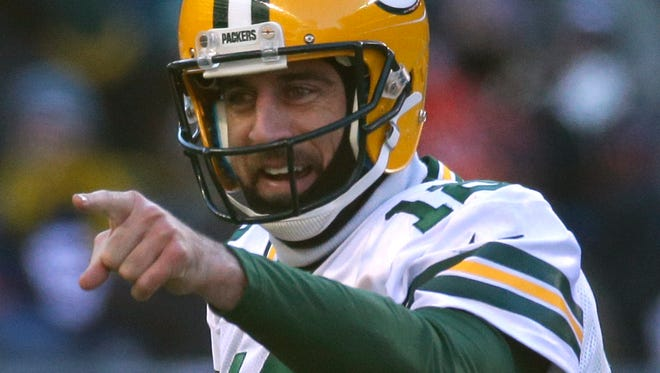 Packers quarterback Aaron Rodgers  reacts after a touchdown vs. the Bears on Dec. 18 at Soldier Field.