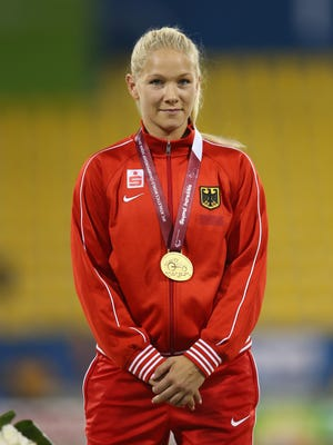OCTOBER 22:  Vanessa Low of Germany poses with her gold medal at the medal ceremony for the women's long jump T42 Final during the Evening Session on Day One of the IPC Athletics World Championships at Suhaim Bin Hamad Stadium on October 22, 2015 in Doha, Qatar.