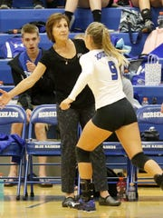 Patti Perone greets a Horseheads player before a match against Owego on Sept. 7, 2017 at Horseheads Middle School.