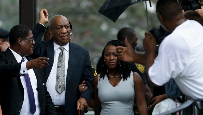 Bill Cosby gestures as he departs the Montgomery County Courthouse after his sexual assault trial ended in mistrial on June 17, 2017, in Norristown, Pa.