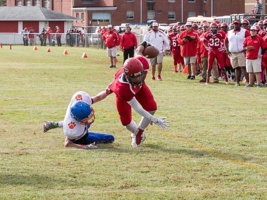 Delmar defensive back Jeffrey Whitten, left, attempts