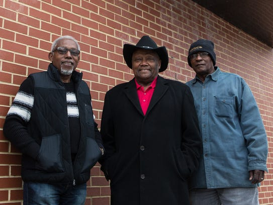 From left, Gregory Meekins, Carlton W. Stanley, and