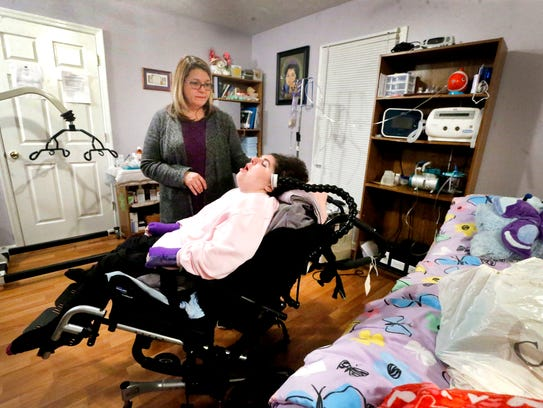 """Rosemarie Roan stands next to her daughter Alison """"Ally"""" Roan,  born with Spastic Quadriplegic Cerebral Palsy. Ally requires full-time nursing care."""