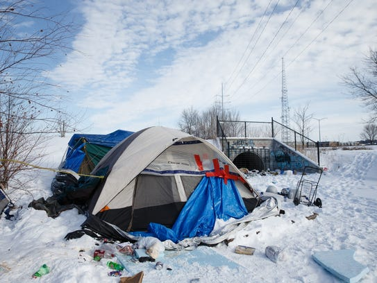 A homeless encampment sits along the railroad tracks between Mulberry Street and Martin Luther King Parkway on Friday, Feb. 9, 2018, in Des Moines.