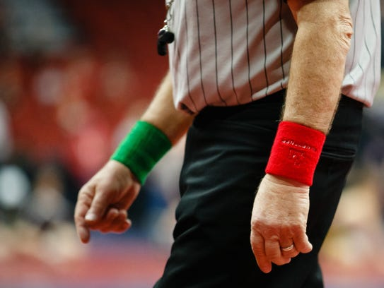 """Referees wear red and green wrist bands that say """"Luft"""