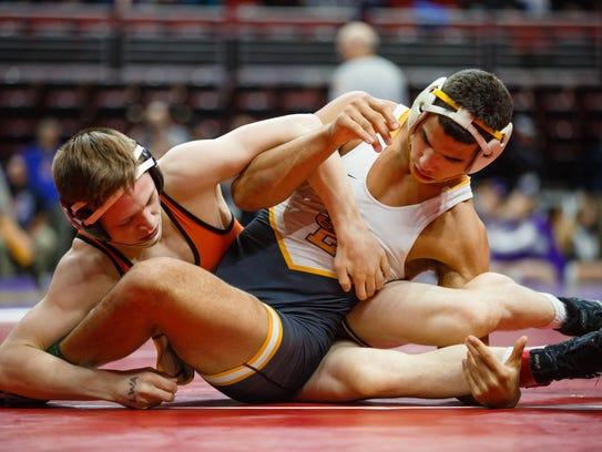 Kobey Pritchard of Southeast Polk wrestles Conrad Braswell