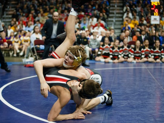 Drake Ayala of Fort Dodge wrestles Cullan Schriever