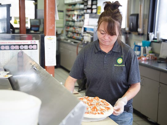 Joey Lewis of Wever makes a pizza at the Wever Junction