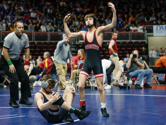 Drake Ayala of Fort Dodge celebrates an 8-2 decision
