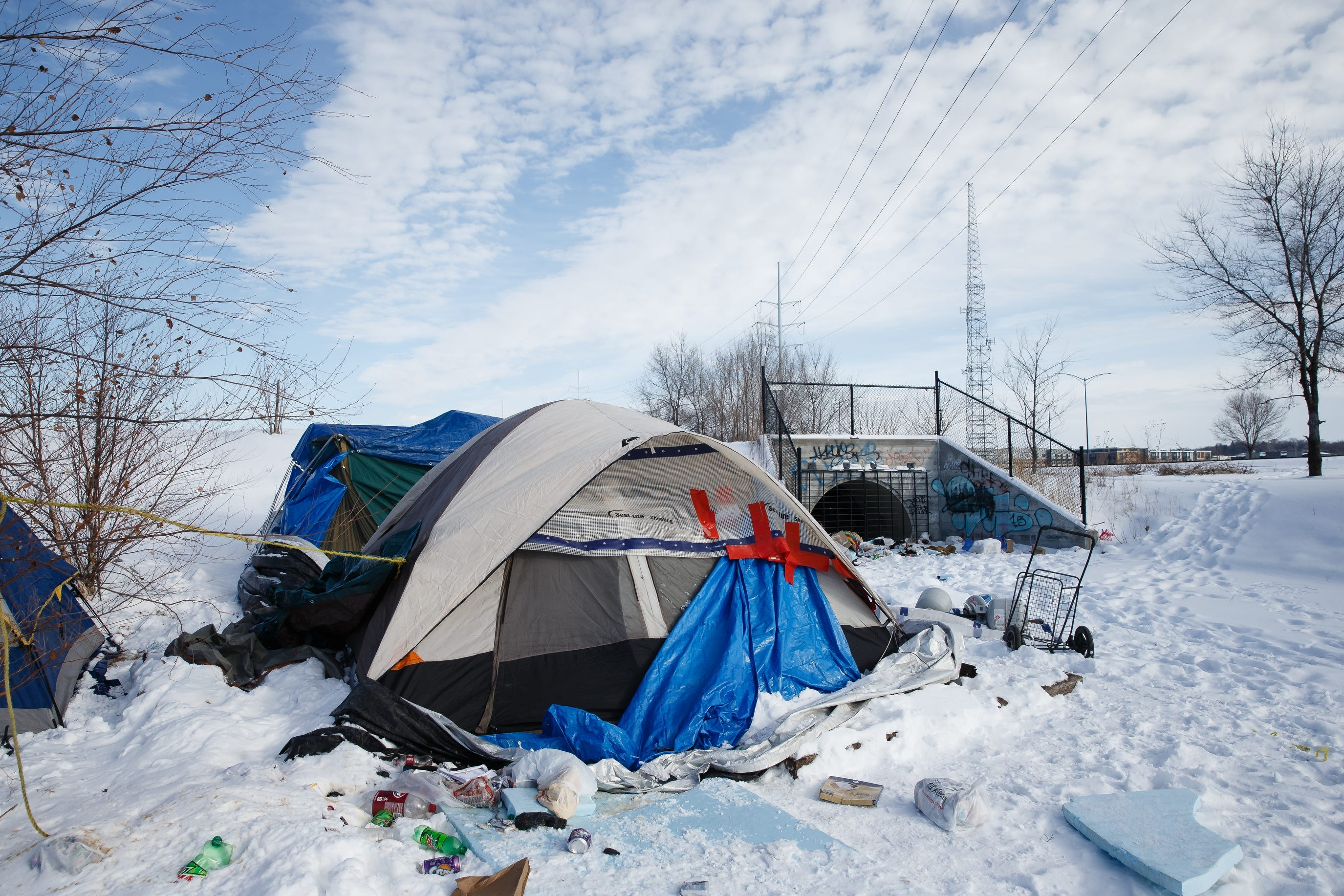 A homeless enc&ment sits along the railroad tracks between Mulberry Street and Martin Luther King Parkway & Des Moines homeless spend long cold winter outdoors