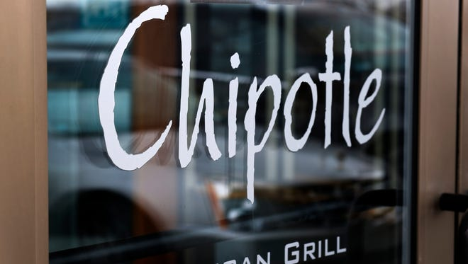 FILE - This Tuesday, Jan. 28, 2014, file photo, shows the door at a Chipotle Mexican Grill in Robinson Township, Pa.   (AP Photo/Gene J. Puskar, File) ORG XMIT: NYBZ212