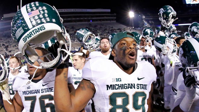 Michigan State defensive end Shilique Calhoun (89) joins his teammates in singing the Michigan State alma mater after a 34-10 win over Penn State in an NCAA college football game in State College, Pa., Saturday, Nov. 29, 2014.