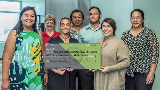 The Bank of Guam is a Sakman sponsor of the 30th anniversary of the university's Micronesia Area Resarch Center. From left, during a check presentation, are: Melanie Mendiola, UOG Endowment Foundation executive director; Rebecca Stephenson, UOG Monique Storie, MARC; Hiro Kurashina, UOG; Kin Cook, BOG Executive Vice President/Chief Sales and Service Officer; Maria Leon Guerrero, BOG Executive Vice President/Retail and Card Services; and Leiana Naholowaa, UOG Endowment Foundation marketing consultant