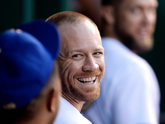 Kansas City Royals' Brandon Moss, center, celebrates with teammates in the dugout after hitting a solo home run during the fourth inning of a baseball game against the Los Angeles Angels, Saturday, April 15, 2017, in Kansas City, Mo. (AP Photo/Charlie Riedel)