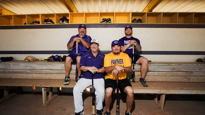 Cypress Lake High School baseball coach, Rick Little, center left, passed the reins over to Anthony Ficarro, center right, after along career as head coach. On the upper left is JV coach Todd Dusenberry. On the upper right is assistant varsity coach, Alex Carcioppolo. Ficarro, Dusenberry and Carcioppolo all teach in the ESE department.