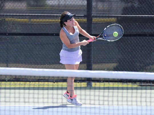 Wylie's Analeah Elias hits a backhand shot during the