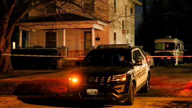 Police investigate the scene where a man and women were found dead in an RV behind a house on Douglas Avenue just south of Atlantic Street after a standoff on Wednesday, Dec. 13, 2017.
