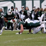 Safety Demetrious Cox picks up a fumble and returns it 77 yards for a touchdown in the second quarter against Penn State Saturday, November 28, 2015, at Spartan Stadium in East Lansing.