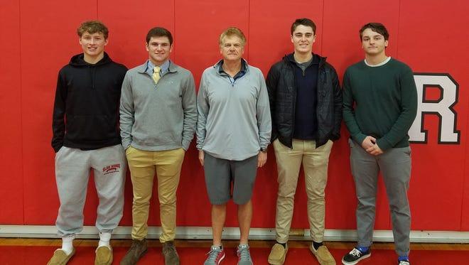 Duke Mendez (center) sharing a moment with the 2017 Glen Ridge football captains, (from left) Tyler Liddy, Joe Marchesano, Max Auborn and Kieran Moran.