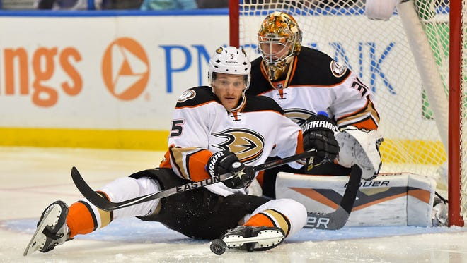 Oct 29, 2015; St. Louis, MO, USA; Anaheim Ducks defenseman Korbinian Holzer (5) attempts to clear the puck in front of goalie Frederik Andersen (31) against the St. Louis Blues during the second period at Scottrade Center.