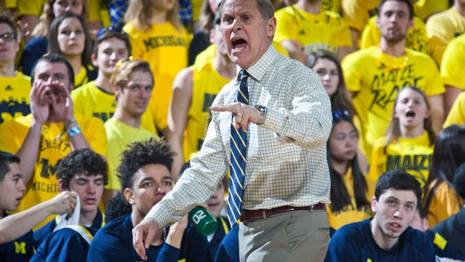 Michigan head coach John Beilein shouts at a referee from courtside in the first half of an NCAA college basketball game against Iowa at Crisler Center in Ann Arbor, Mich., Thursday, Feb. 5, 2015.