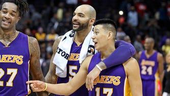 Jeremy Lin (17) and Carlos Boozer (5)