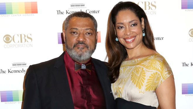 Laurence Fishburne and Gina Torres attend the Kennedy Center Honors in Washington on Dec. 6, 2015.
