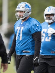 Lions tackle Rick Wagner watches drills during organized