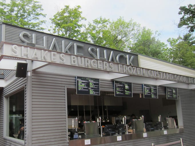 The steel and 3-D lettering is the unifying look of various Shake Shack locations, which include standalone restaurants and outlets in stadiums and sports venue. This is a seasonal one at upstate New York's Saratoga racetrack.