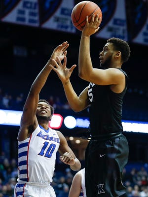 Xavier Musketeers guard Trevon Bluiett (5) shoots against DePaul Blue Demons forward Tre'Darius McCallum (10).