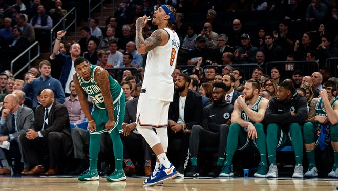New York Knicks' Michael Beasley, center looks at the screen during the second half of an NBA basketball game against the Boston Celtics at Madison Square Garden in New York, Thursday, Dec. 21, 2017.