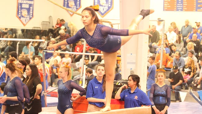 Central High School's Anna James earned a 9.35 on balance beam and tied for third in a meet against Odessa Permian and Odessa High at the James R. White Gymnastics Center on Thursday, March 1, 2018.