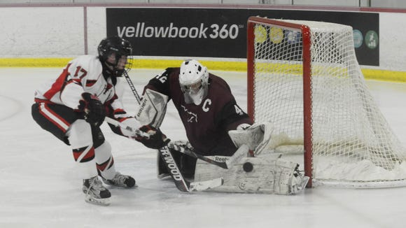 Clifton's goalie Tyler Gibson (42) blocks a shot from Lakeland's Andrew Heck (17) during Monday's Passaic County ice hockey final. Both are among the the North Jersey leaders at their positions.