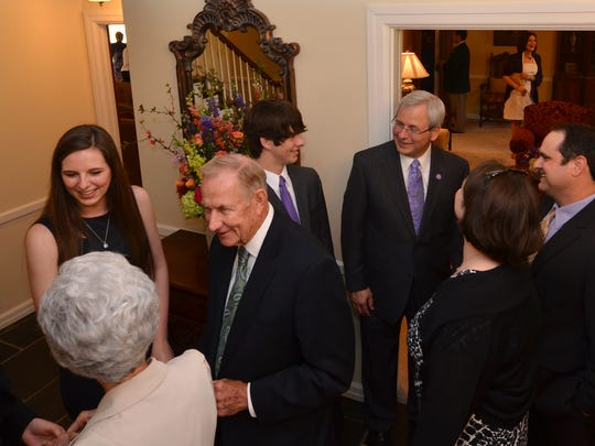 Following Friday's formal investiture ceremony, Jim and Tonia Henderson and their family opened the Northwestern State University President's Home for a community reception, in which well wishers congratulated the new first family.