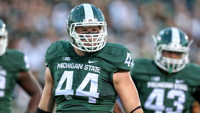 Michigan State defensive end Marcus Rush stands on the field Oct. 25, 2014, at Spartan Stadium.