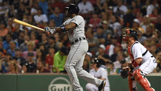 Tigers leftfielder Justin Upton (8) hits a grand slam during the fifth inning Sunday in Boston.