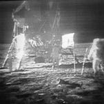 In this July 20, 1969 file photo, Apollo 11 astronaut Neil Armstrong, right, trudges across the surface of the moon leaving behind footprints.