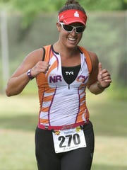 Jemila Najjar-Keith of Jefferson, a special-education teacher at Troy Hills Elementary in Parsippany, celebrates as she crosses the finish line to win the Randolph Lake Triathlon in 2012.
