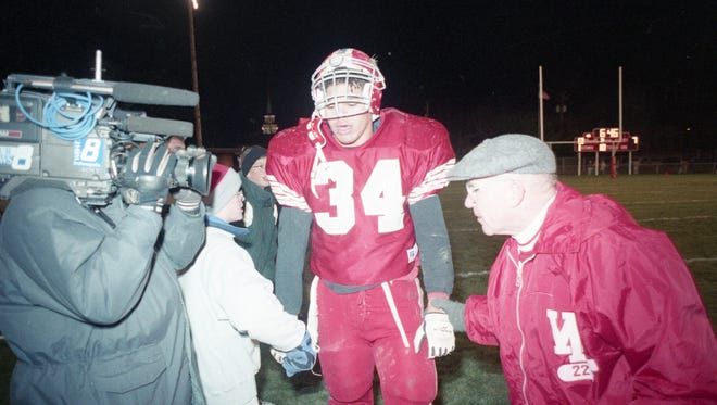 WL coach Ernie Beck and fullback Chike Okeafor on the sidelines after a 1993 victory.