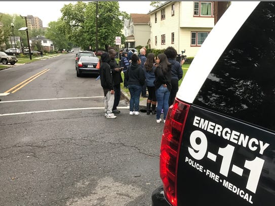 A crowd gathers in Hackensack to watch as the SWAT