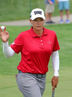 Defending champion Katherine Kirk acknowledges the fans after a birdie on the seventh hole during the Thornberry Creek LPGA Classic first round Thursday in Hobart.