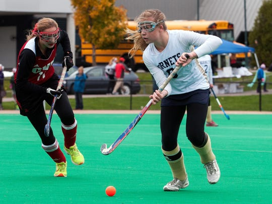Essex's Kathleen Young (9) looks to pass the ball during 2014 Division I field hockey championship game against Essex at Moulton-Winder Field.