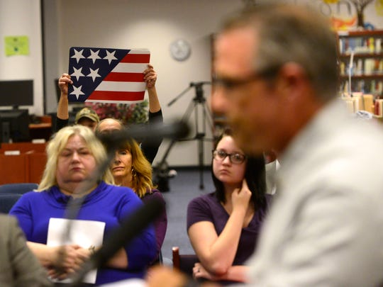 A crowd gathers at Pace High School on Tuesday during a Santa Rosa County Delegation meeting about proposed changes to a statute regarding the Pledge of Allegiance in the classroom.