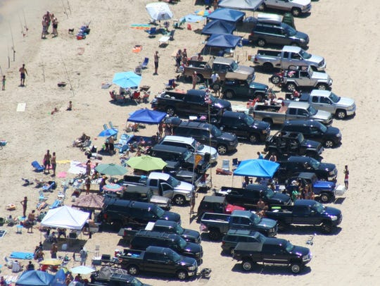 Overcrowding is an issue Delaware state parks officials are trying to address on surf fishing beaches. This file photo shows cars double parking before a law change.