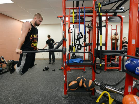 Students in the Mid-East Career and Technology Center criminal justice program work out in a gym installed for the program during the center's recent remodel.