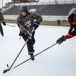 What The Pucks' Owen Lawson, 15, works the puck down ice during a pond hockey tournament Saturday, Jan. 30, 2016 at Memorial Stadium in Port Huron.