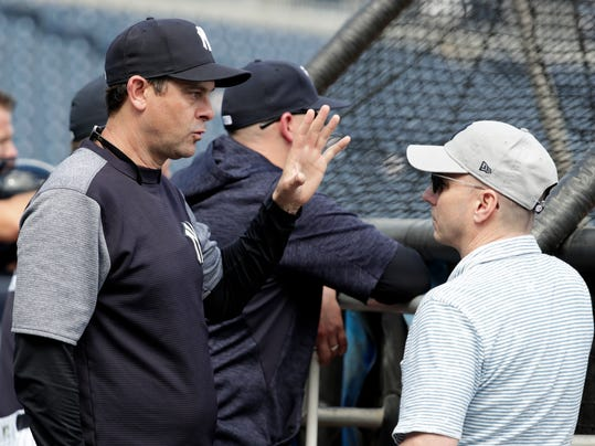 New York Yankees manager Aaron Boone talks with Yankees General Manager Brian Cashman at baseball spring training camp, Wednesday, Feb. 21, 2018, in Tampa, Fla. (AP Photo/Lynne Sladky)